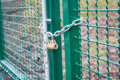 Locked gate. Padlocked chain link on fence Stock Images