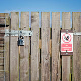 Locked gate. A locked wooden gate with a no access notice Stock Photo