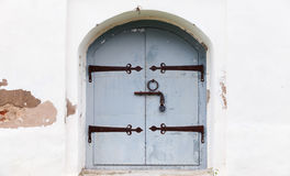 Locked gray wooden door with arch Royalty Free Stock Photography