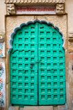Locked green door Royalty Free Stock Photo