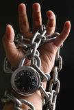 Locked hand. A hand locked with chain and combination lock Royalty Free Stock Photos