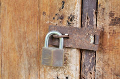 Locked key on old wooden door Stock Photography