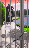 The locked lattice in front of the statue of Herculean. Locked grilles with text on the visitor leaflet in Russian: for your safety the entry is forbidden Royalty Free Stock Photo