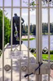 The locked lattice in front of the statue of Hercules. The locked lattice with the text on a leaf to visitors in Russian: For your safety the entrance is Royalty Free Stock Images