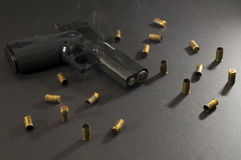 Locked and loaded. Picture of a smoking gun Royalty Free Stock Image