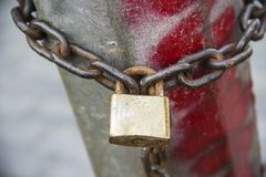 Locked lock with the chain around the post. royalty free stock photo