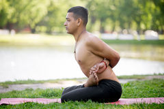 Locked Lotus pose in park Stock Images