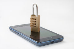 Locked mobile phone with padlock combination Royalty Free Stock Photography