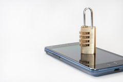 Locked mobile phone with padlock on the right side of the image Royalty Free Stock Images