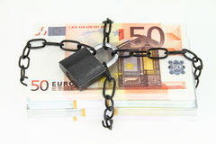 Locked money Stock Photo