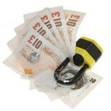 Locked money. Cash locked in a padlock on white background Royalty Free Stock Photos