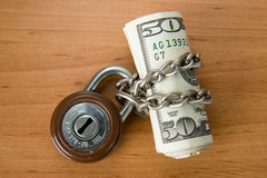 Locked money Stock Images