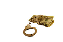 Locked by Money Issues. Locked into money issues by Money in the form of many large bills and handcuffs Royalty Free Stock Photo