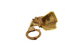 Locked into Money Issues. With large bills and handcuffs Royalty Free Stock Images