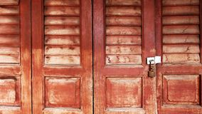Locked Old Vintage Wooden Door with Ventilation Grille. Louver Royalty Free Stock Photography