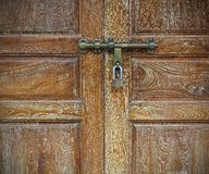Locked old wooden door Royalty Free Stock Images