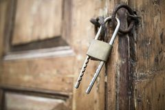 Locked old wooden door royalty free stock photography