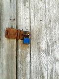 Locked old wooden door vertical Stock Photos