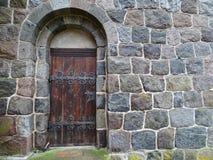 Locked old wooden door Stock Images