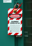 locked out and tagged out. Lock out tag protects workers from equipment being used Royalty Free Stock Images