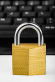 Locked padlock with a black computer keyboard Stock Photos