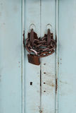 Locked padlock and chained on galvanize metal sheet door Royalty Free Stock Image