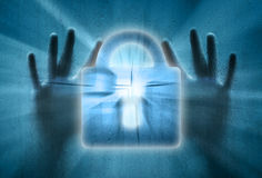 Locked padlock with human hands Royalty Free Stock Images