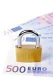 Locked padlock and money Royalty Free Stock Photos