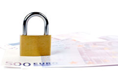 Locked padlock and money Royalty Free Stock Photography