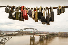 Locked Padlocks and a Bridge Construction Stock Photos
