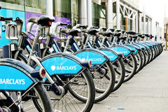 Locked and parked London hire bikes. This is an image of locked and parked Barclays Bank sponsored bicycles - a scheme that was introduced by London mayor Boris royalty free stock photos
