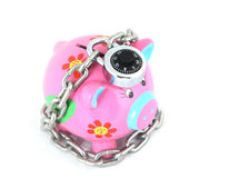 Locked Piggy Bank. Isolated over white background Royalty Free Stock Images