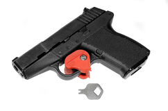 Locked Pistol. A pistol that has the trigger locked with a key.  A firearm safety feature Stock Images