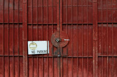 Locked red rusty metal door, safety concept Stock Images
