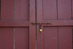 Locked red wood doors from inside Royalty Free Stock Photography