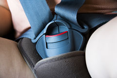 Locked safety belt in car seat Stock Images
