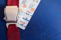 Locked seatbelt and instruction lay on the chair. Stock Photos