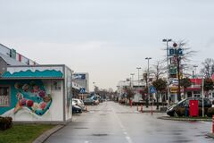 Free Locked Shops And Stores And Empty Parking Lot Of A Closed Mall In Pancevo, Due To Lockdown And Shorted Working Hours During Covid Royalty Free Stock Images - 213926539