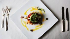 Locked-on shot of seafood served in plate, Hotel Amar Villas, Agra, Uttar Pradesh, India stock video