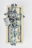 Locked stack of dollar bills. Royalty Free Stock Image