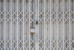 Locked steel shutter door Royalty Free Stock Photos