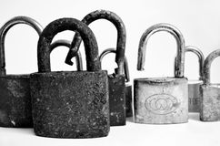 Locked and unlocked. A group of 8 old locks on a white background. Some of them are locked and some of them are unlocked Royalty Free Stock Images