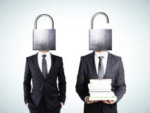 Locked and unlocked minds of businessmen concept Stock Images