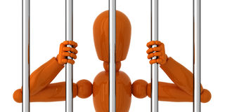 Locked up. Orange mannequin to be behind bars Royalty Free Stock Photos
