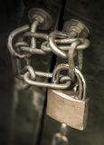 Locked-up. Safely locked-up doors with a big lock Royalty Free Stock Photos