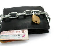 A locked wallet. A black wallet locked by a chain and a padlock Royalty Free Stock Images