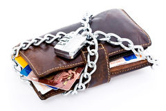 Locked wallet and credit cards. Leather wallet with credit cards and Euro currency locked with a chain and combination lock, isolated on white background Royalty Free Stock Image