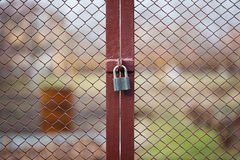 Locked wire mesh fence on private land Stock Photo