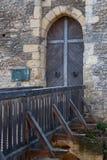 Locked wooden door of the castle Stock Images