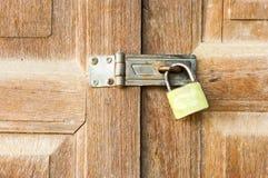 Locked wooden door. Door of house Stock Photography